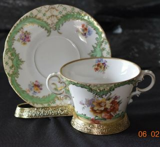 Vintage Austria Two Handled Porcelian Cup And Saucer