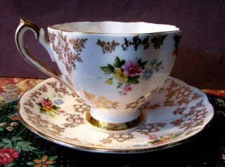 Fine Bone China: Tea Cup And Saucer England Crown Mark
