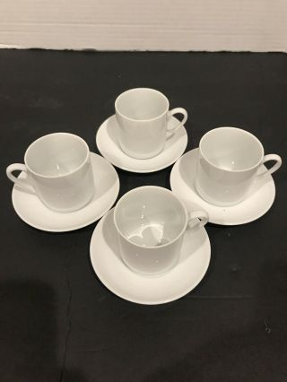 Four Vintage White Porcelain Demitasse Cups And Saucers