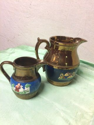 Copper Lustre Jugs With Relief Molded Figures Beaded Bands